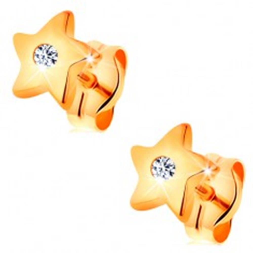Šperky eshop Náušnice v žltom 14K zlate - lesklé hviezdičky s čírym zirkónom uprostred