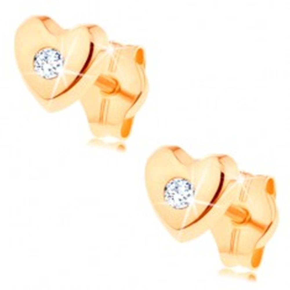 Šperky eshop Puzetové náušnice v žltom 14K zlate - lesklé vypuklé srdiečko, číry zirkón