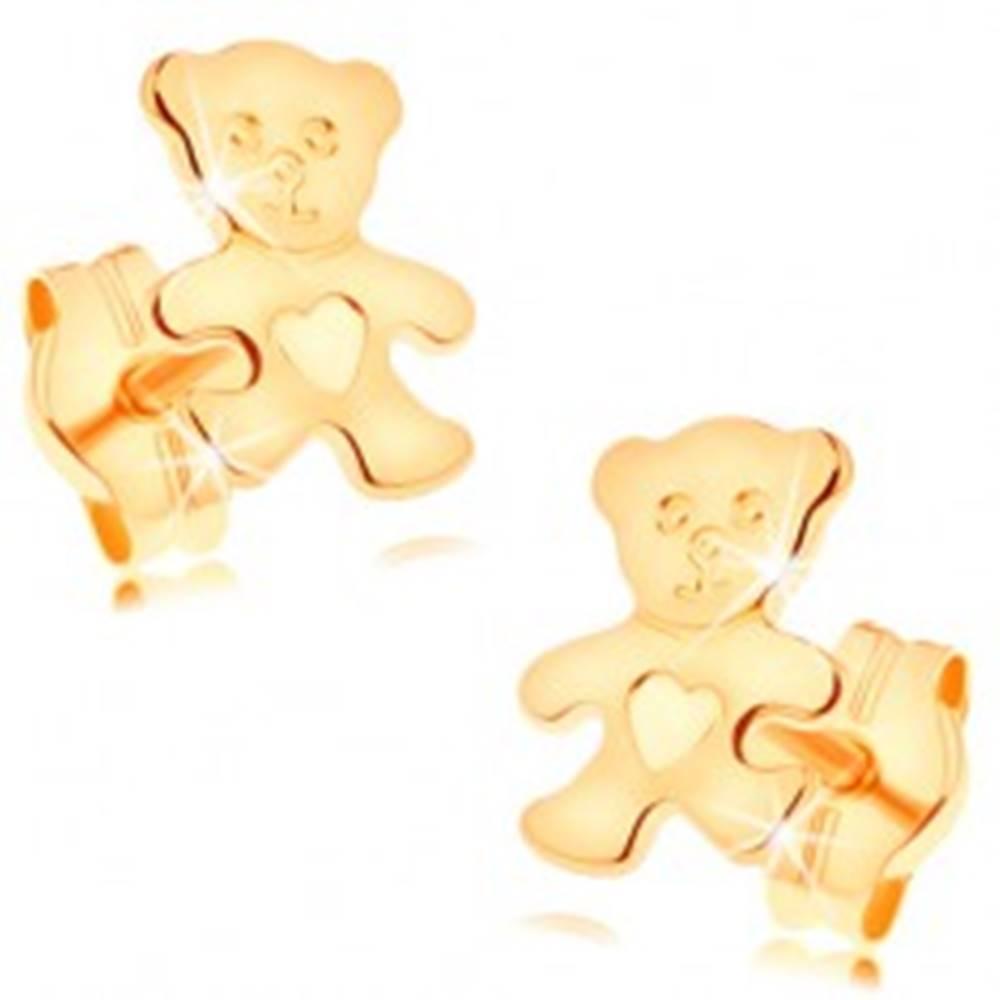 Šperky eshop Náušnice zo žltého 14K zlata - ligotavý plochý medvedík so srdiečkom na brušku