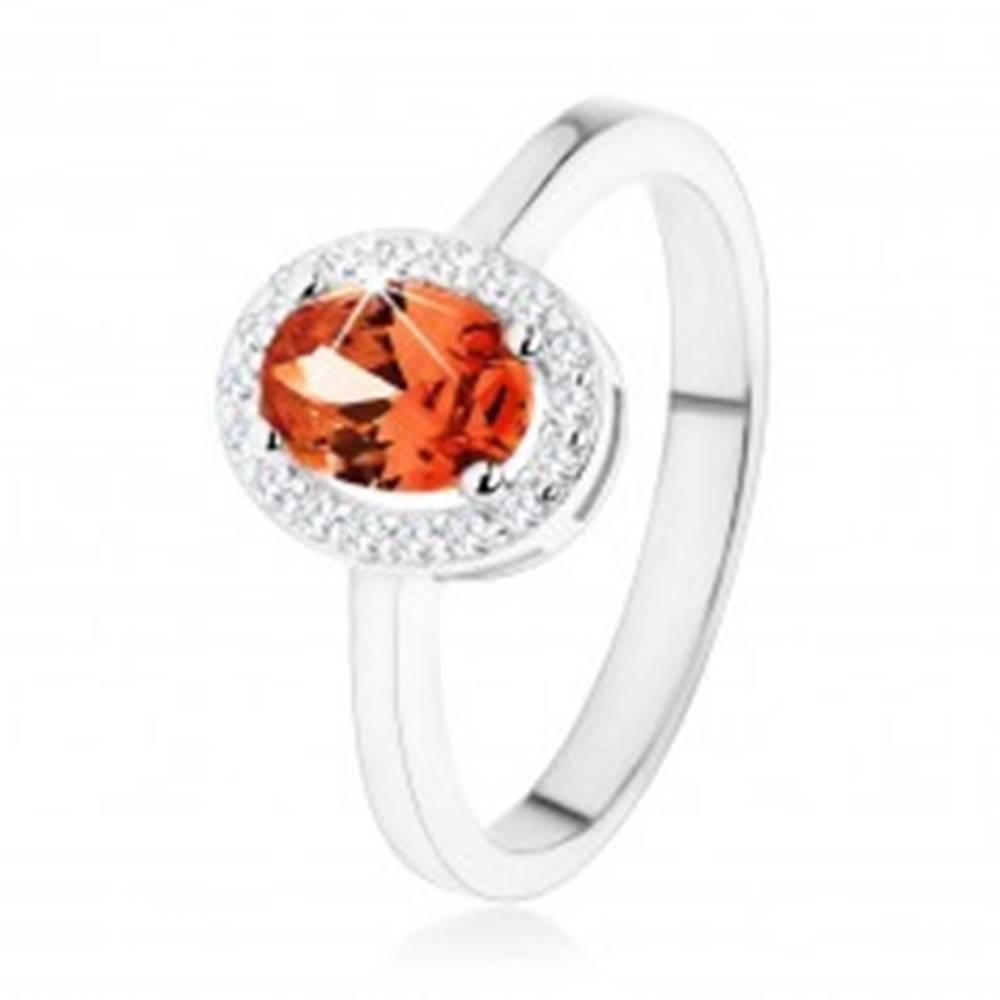 Šperky eshop Strieborný prsteň 925, tmavo oranžový oválny zirkón, číry ligotavý lem - Veľkosť: 48 mm