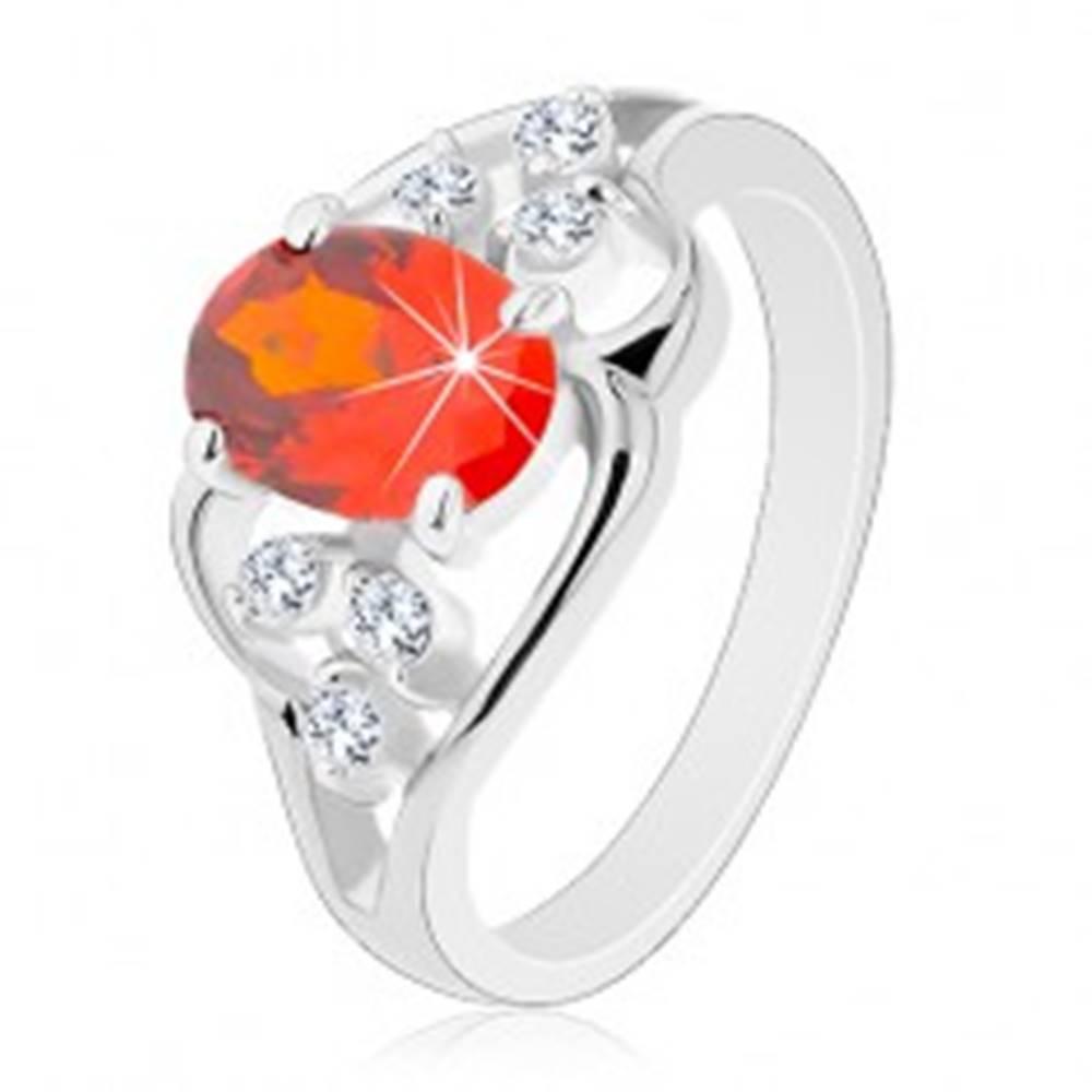 Šperky eshop Prsteň v striebornom odtieni, oranžový oválny zirkón, zvlnené línie - Veľkosť: 51 mm