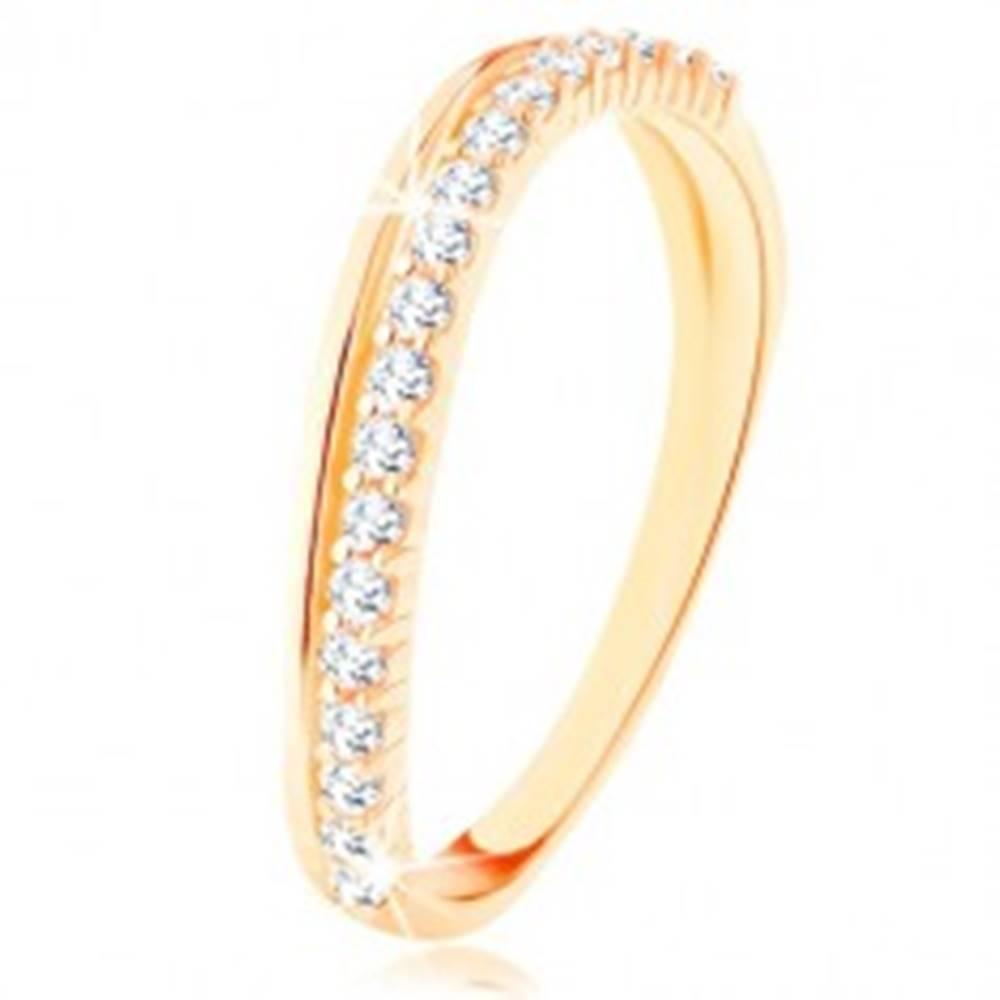 Šperky eshop Prsteň zo žltého 9K zlata - hladká a číra zirkónová zvlnená línia - Veľkosť: 50 mm